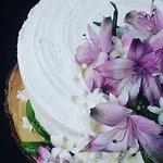 Beautiful,delicious wedding cake, fresh flowers.