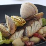 Coral Coast Barramundi, Clams, Potato gnocchi, speck, prawn consumme