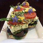 Haloumi cheese, roasted capsicum, mushroom  bagels with borage flowers & rocket