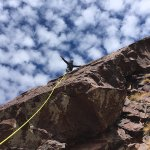 Scaling a rock face with Climb Morocco
