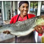 Chef Geaorge holds a giant Salmon