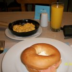 bagel, cream cheese, smoked salmon with scrambled eggs and mango drink