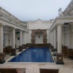 The rooftop swimming pool is very inviting, and has poolside tables for a quiet read and coffee