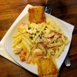 Penne pasta alfredo loaded with shrimp and lobster
