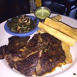 Steak frites, Angus ribeye, chimichurri glace, yucca frites, braised collard greens