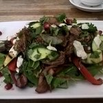 Greek sald and slow cooked lamb. Under all this was a flat bread. Delicious!