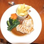 Chicken, gravy, chips and vegetables