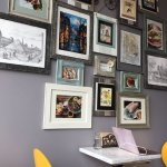 Cute marble tables and gallery wall decor.