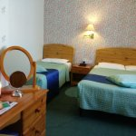 Comfortable beds, writing desk with literature, vanity mirror, salt lamp, wardrobe and kettle