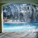 Taken from behind a decorative waterfall by the pool