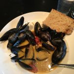 Steamed Mussels with Chardonnay, Lemon,Garlic, Herbs, Capers, Roasted Tomato