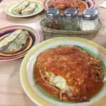Chicken parmesan and spaghetti sauce with bread