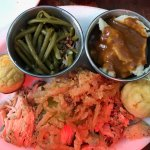 Pulled Chicken topped with Onion Rings, Skinny Beans, Mashed Potatoes, & Corn Muffins