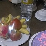 Birthday cake , fresh fruit and water presented by Hotel