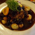 One of the daily specials, crispy pork, sautes and a black cherry sauce plus vegetables.