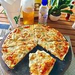 best fromagio pizza ive ever had gorgonzola, camenbert, goats cheese, mozzarella on a thin, cris