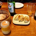 some dim sum, peach pudding and beer