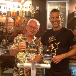 Ant and a very satisfied guest behind the Bar!