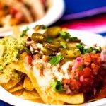 Loaded veggie Nachos with fresh Guacamole, tomato salsa, sour cream & jalapenos