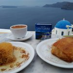 Greek pastries and coffee overlooking caldera