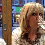 A recent visitor to Amarcord savours her complimentary glass of prosecco.