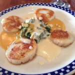 Scallops with spinach.
