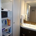 Ample wardrobe and shelving space / albeit weirdly situated at the side of the washroom sink?