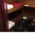 There are bunks along the interior wall and arranged in small rooms like this
