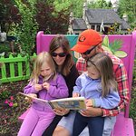 Reading the book that goes with the attraction. Lots of spots to sit with the kids.