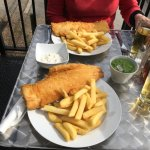 Two haddock and chips seated outdoors at brilliant Maggie's