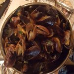 This huge golden bowl of mussels steamed in white wine, was irresistible