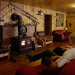 Lounge with a cozy woodstove