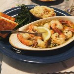 Buttery, garlicky prawns with broccollini and mashed potatoes