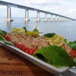Indulge in Coastal Cuisines prepared on-board by our chefs while cruising into the sunset