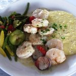 Gulf Shrimp & Grits  Featuring Local, Organic Stone-ground Grits w a zesty Shrimp & Andouille Sa