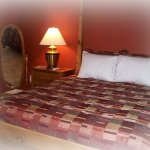 The Pine Suite A queen bed with a private bathroom