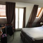 Our room with gables and french doors to city view