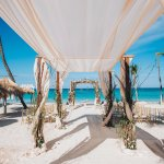 Multiple arches for ceremony setup at Kukua Punta Cana