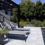 Outdoor 12 m swimming pool & lounge chairs