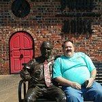 My friend with Truitt Cathy, the founder of Chick-Fil-A, in front of the Dwarf Door