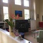 Common Gathering area with fireplace. Perfect place to relax or watch the big screen TV
