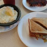 chorizo egg and cheese sandwich with cheezy grits