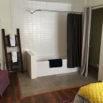 Luxurious shower and soaking tub in the Downstairs Queen room
