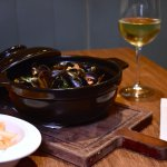 MUSSELS MARINIERE AND FRIES served in cocotte, fresh tomato and garlic