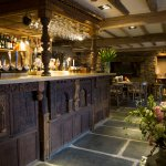 The iconic four poster bed bar at the Queens Head
