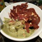 Dessert - dough balls with pistachio and chocolate sauce