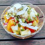 Ginger and lime fruit salad, with greek yoghurt, local honey and pepita crunch mix