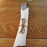 Cutlery all clean and wrapped in the Napkin tied with Twine,
