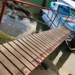 Boat dock to the resort on the river