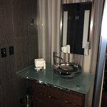 Modern glass bathroom - lighted mirror